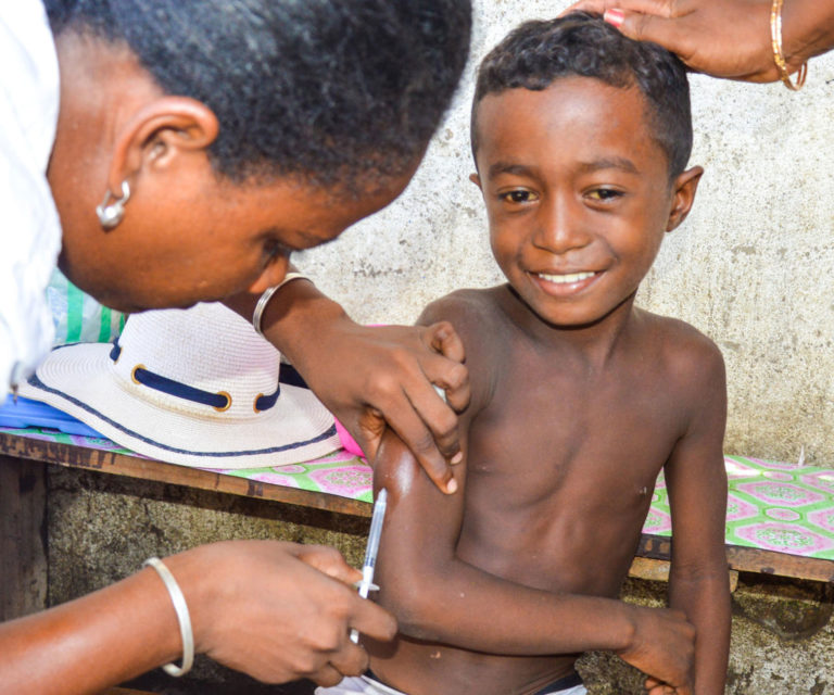A child receives a measles vaccine